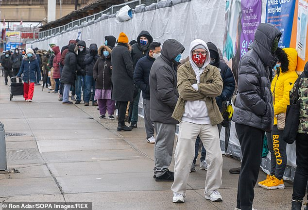 It comes on the same day the U.S. reported 3,775 deaths to due to the virus, the highest single-day record since the pandemic began. Pictured: New York City residents wait in a line outside a COVID-19 testing site through NYC Health + Hospitals in Queens, January 3