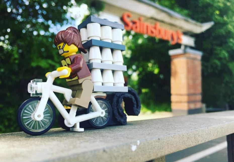 A Lego minifugure stocking up on loo rolls.