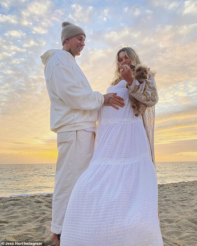 It's official!In October, James proposed to the model in front of her family and friends at their beachside baby shower in Malibu, California
