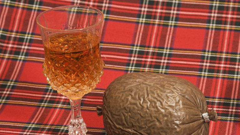 """Scotch whisky in a crystal thistle glass with a haggis on a tartan backdrop.  Traditional Scottish fayre, particularly on Burns Night.Similar images from my portfolio:"""