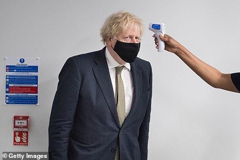 Boris Johnson will address the nation at 8pm tonight. He is pictured above today on a visit to a hospital in London