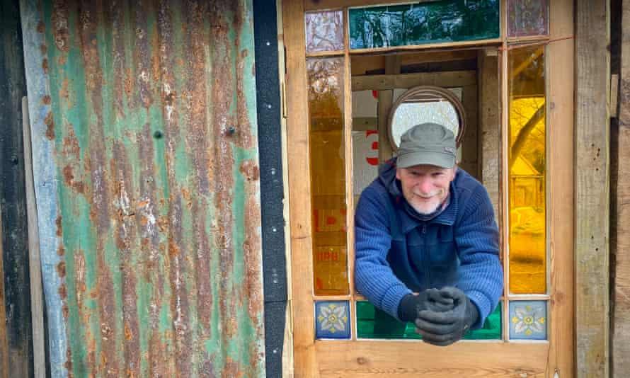 Taking shape … 'scrounging has resulted in a fine Victorian glass door' for the author's hut