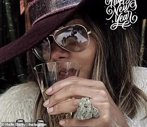 Bubbles: Halle Berry raised a toast to 2021 with this photo