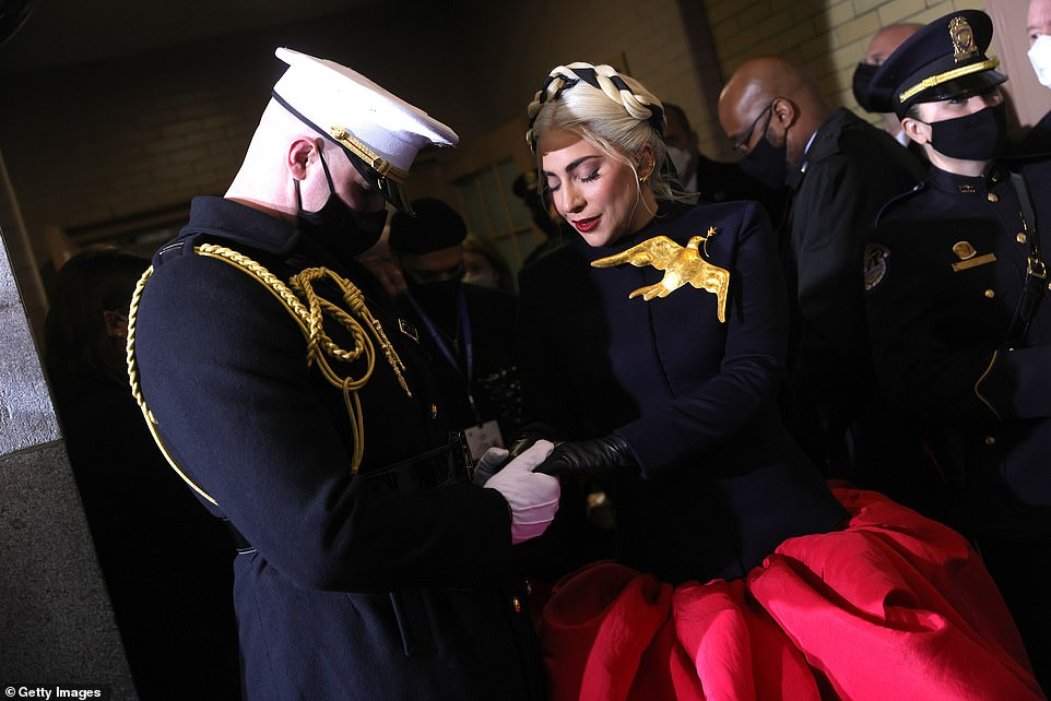 Honored: The Academy Award nominee held hands with a Marine and said a prayer before her performance