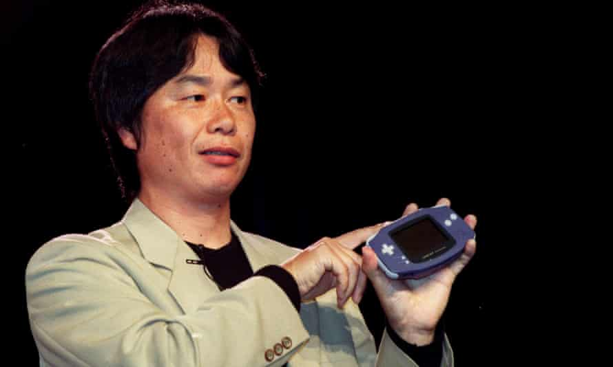 Video game developer Shigeru Miyamoto holds up the new Nintendo Game Boy Advance, 2001.
