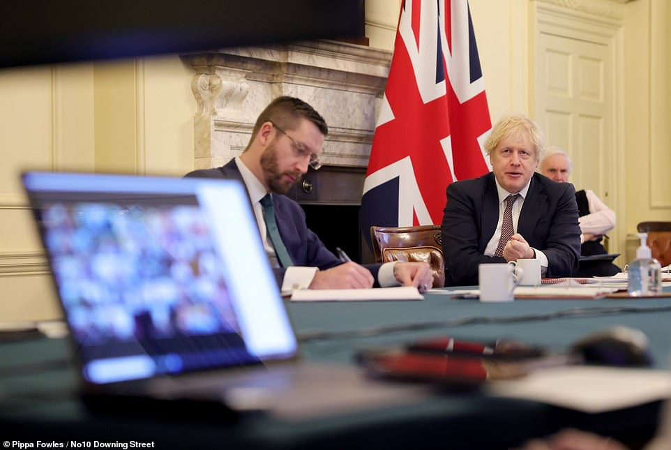 Boris Johnson (pictured taking Cabinet today) is under pressure frommembers of the Sage scientific advisory panel to increase the social distancing gap