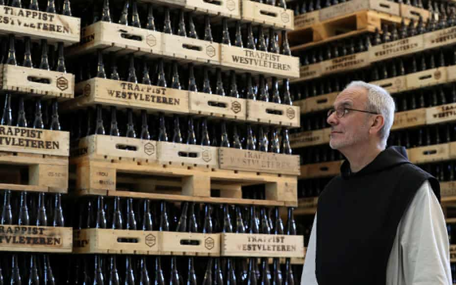 Trappist monk amid bottles of Westvleteren beer at the bottling plant in Westvleteren, Belgium.