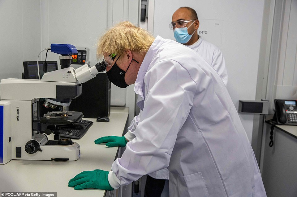 Boris Johnson was shown the vaccine quality control systems on a visit to Oxford Biomedica in Oxfordshire today