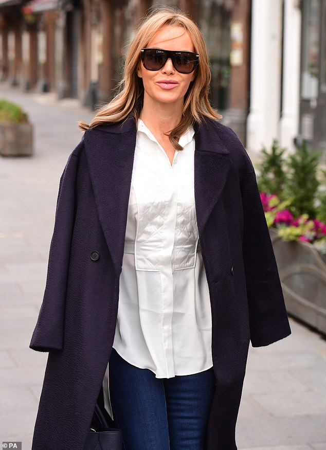 Don't mind me:The fashion conscious presenter kicked off the week by catching the eye as she left work after co-hosting her daily breakfast show alongside Jamie Theakston