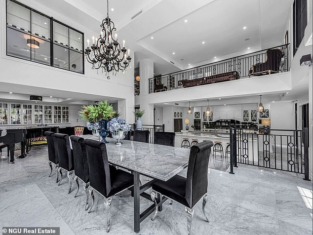 How gorgeous is this! The property boasts a five-car garage, media room, five bathrooms, magnificent living and dining rooms, and an exquisite kitchen with the latest appliances, dual island benches, marble finishes and a full-size cold room