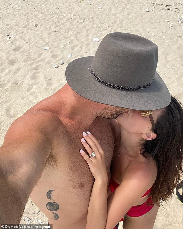 'The man of my dreams proposed to me': Olympia announced she is engaged to her AFL star boyfriend Thomas Bellchambers last October in a gushing post about the pair