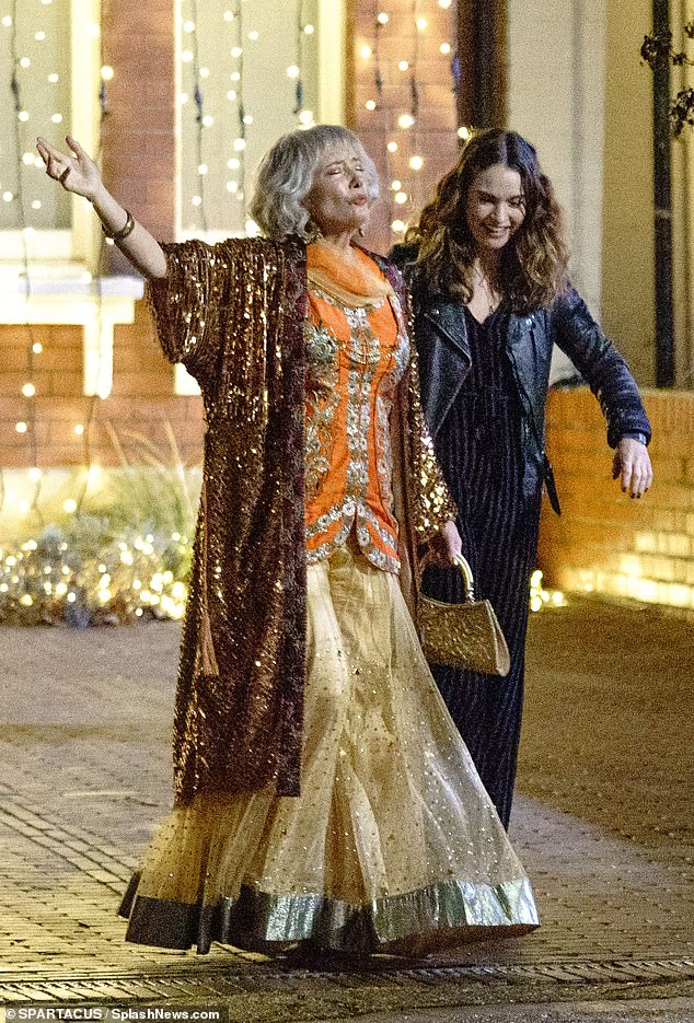 In eye-catching traditional Indian dress, an animated Dame Emma Thompson beams with delight while filming with Lily James in West London for the forthcoming romantic comedy What's Love Got To Do With It?