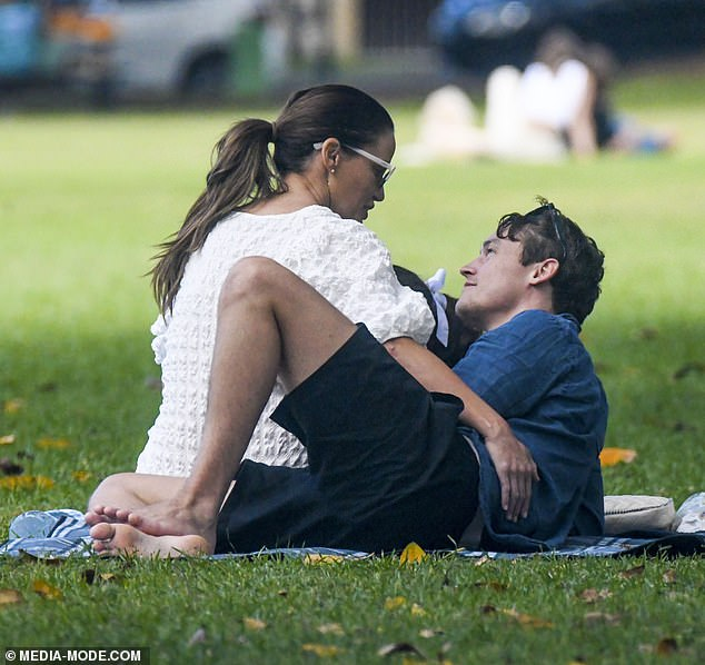 Get a room!Jodi Gordon cosied up to her boyfriend, Sebastian Blackler, as they enjoyed a picnic with her daughter, Aleeia, in Sydney on Valentine's Day