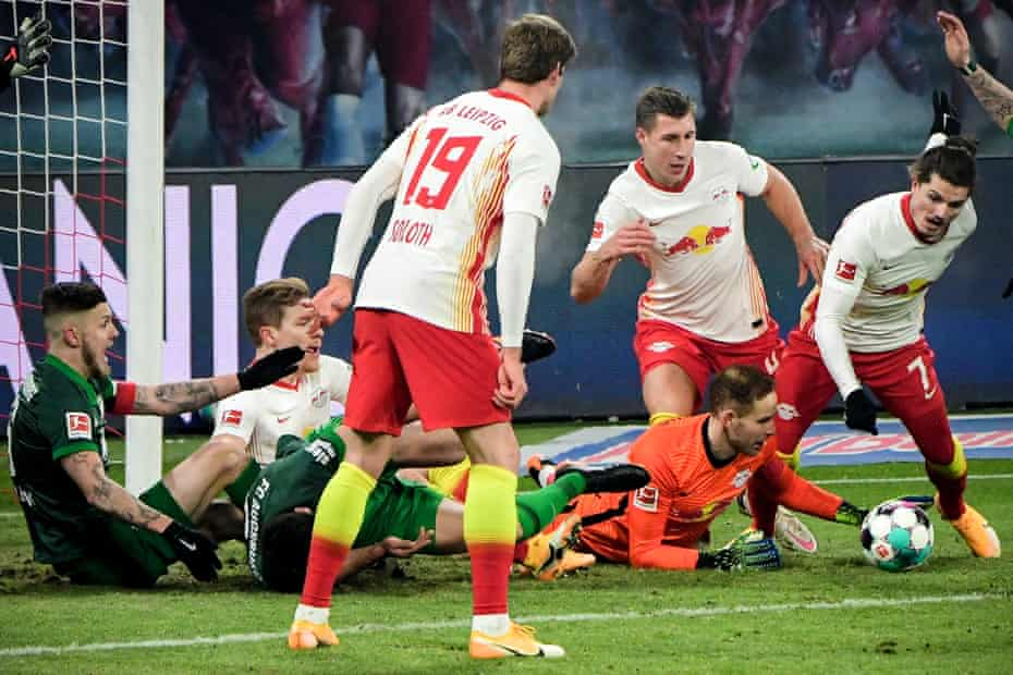 Leipzig's former Liverpool goalkeeper Peter Gulacsi (bottom right) in action during the 2-1 victory over Augsburg on Friday.