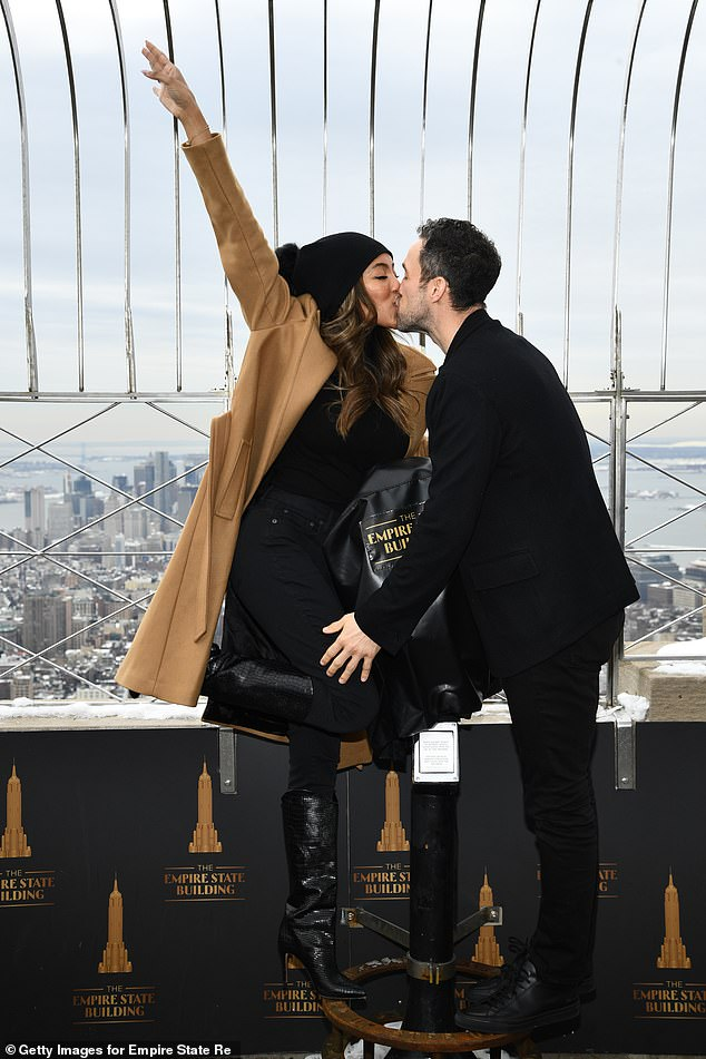 Lovebirds: Tayshia Adams and fiancé Zac Clark took their love to new heights as they enjoyed a tour of the Empire State Building in New York City on Thursday
