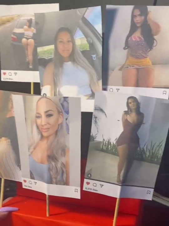 Images of different women on Instagram stuck on wooden stick