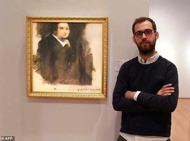 Pierre Fautrel, a member of the French art collective Obvious, poses in front of 'Portrait d'Edmond Belamy,' an image created using artificial intelligence that sold for a whopping£337,000 in 2018