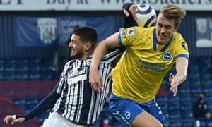 West Bromwich Albion's Okay Yokuslu (left) concedes a penalty for handball.