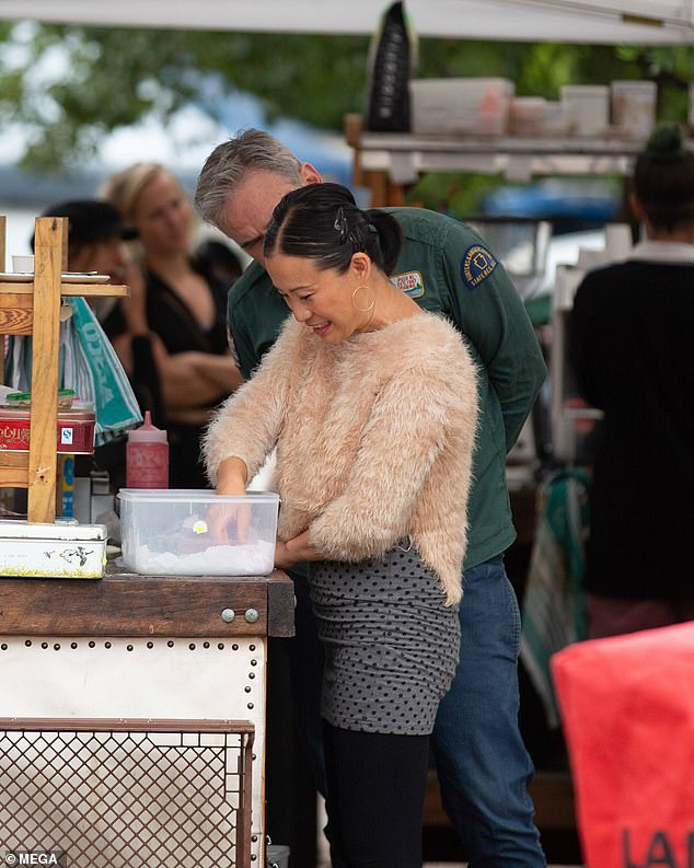 Friendly exes: The 48-year-old was joined by her first husband Matt Phipps, who lent her a helping hand at the stall (both pictured)