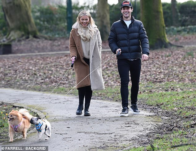 Happy couple: She sported chunky boots and styled her blonde locks in loose waves while wearing natural make-up
