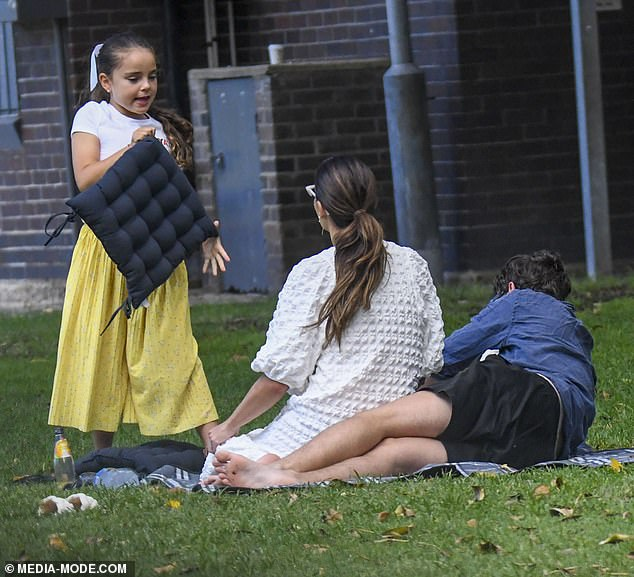 Beauty: The former Neighbours actress tied her long brunette hair in a ponytail