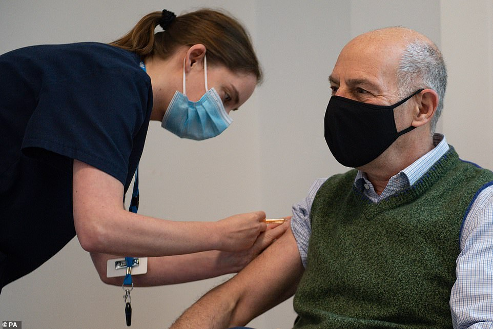 Broadcaster and author Loyd Grossman receives the AstraZeneca vaccine at North Cotswold Hospital in Gloucestershire