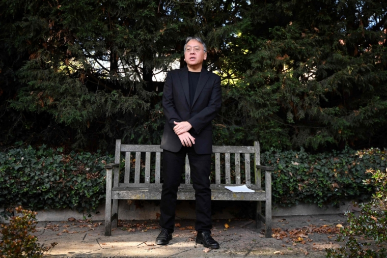 """British author Kazuo Ishiguro holds a press conference in London on October 5, 2017 after being awarded the Nobel Prize for Literature. Kazuo Ishiguro, the 62-year-old British writer of Japanese told British media that winning the 2017 Nobel Prize for Literature today was a """"magnificent honour"""" and """"flabbergastingly flattering"""". / AFP PHOTO / Ben STANSALLBEN STANSALL/AFP/Getty Images"""