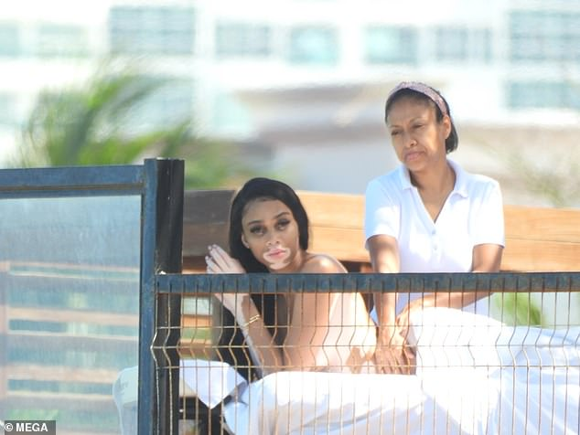 Well-deserved break:Sporting just a white towel, the catwalk queen tapped into full relaxation mode as she chilled at her resort