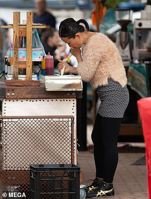 Poh looked chic in a fluffy blush jumper with a grey polk-a-dot skirt, which she paired with leggings and sneakers