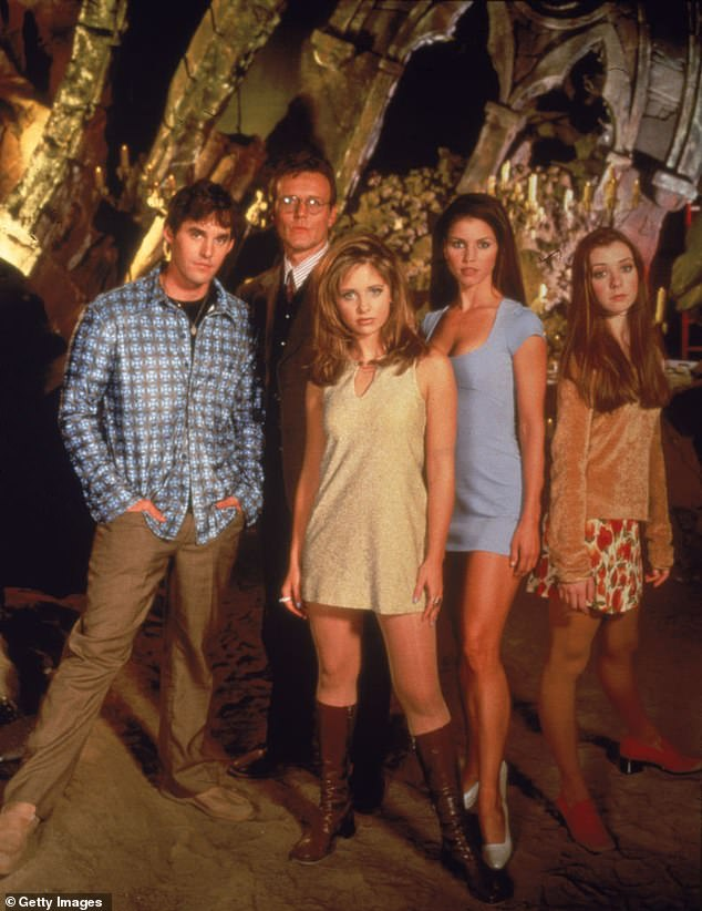 Opinion: Brendon, (left) said he supports co-star Charisma Carpenter, (second from right), 100%' and 'loves [her] very much' following the allegations she made (still from Buffy in 1997)