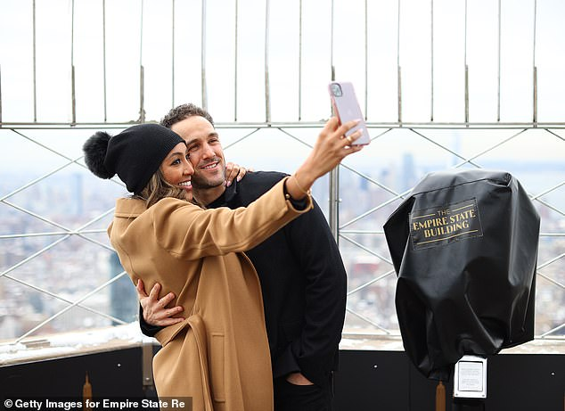Sweet moments: In addition to snapping selfies with the unobstructed skyline behind them, the reality stars shared a kiss ahead of their first Valentine's Day together