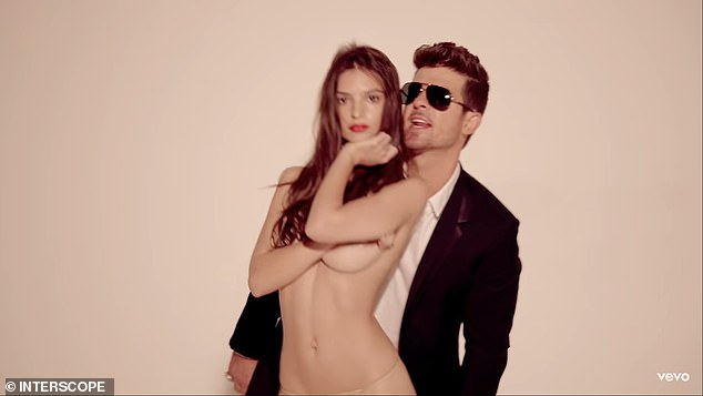 Paying up: Williams and his co-songwriter Robin Thicke lost a 2015 judgment and a 2018 appeal and were forced to pay more than $5 million to the estate of Marvin Gaye for plagiarizing the 1977 song; still from Blurred Lines with Thicke and Emily Ratajkowski