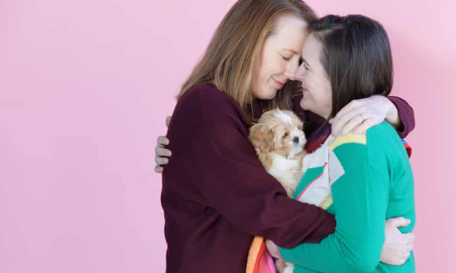 Rachelle and Kerry Howells-Brewer and Rainbow the pup, London