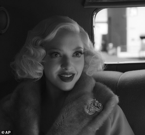 Topping the list:Leading the way for this year's films was Mank, David Fincher's long awaited depiction of the behind-the-scenes battles that plagued the 1941 classic film Citizen Kane (pictured:Amanda Seyfried as Marion Davies)