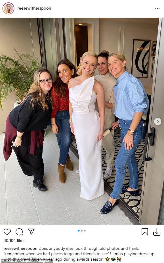 White light: The mother-of-three who is wed to Jim Toth looked stunning in a white dress from a previous year; seen with her team