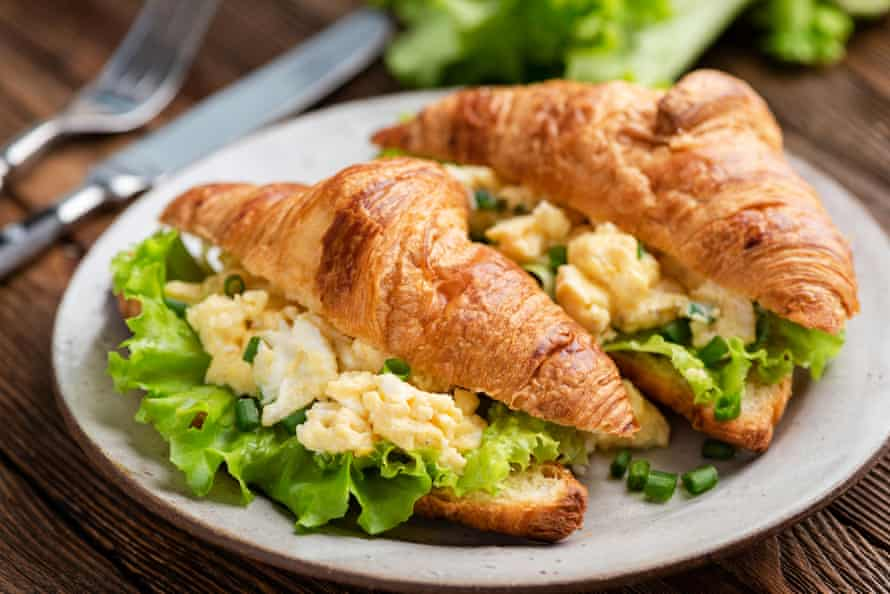A scrambled egg and lettuce croissant