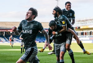 Joyous scenes at Kenilworth Road as Josh Windass (left) celebrates scoring Sheffield Wednesday's first goal.