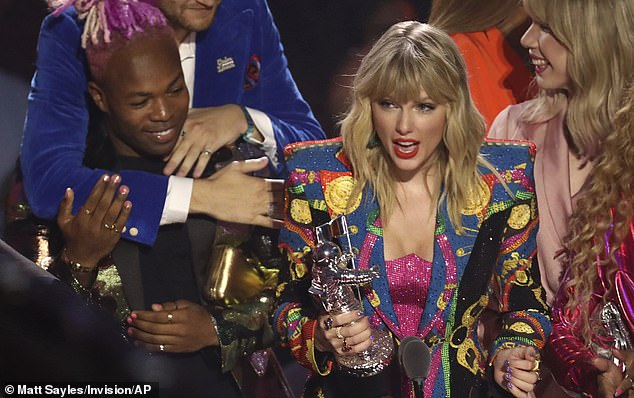 Thankful:'I want to thank everyone who signed that petition, because it now has half a million signatures which is five times the amount that it would need to warrant a response from the White House,' she explained, before going on to thank those who participated in the music video; Taylor pictured in 2019