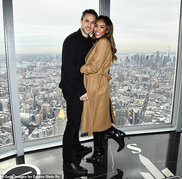 Empire State of Mind: The couple, who became engaged after meeting on The Bachelorette this summer, looked blissful as they took in the stunning views of the Big Apple