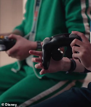 Era: We see in another cut-scene that their video game controllers keep changing to different eras
