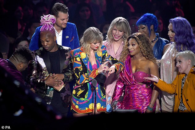 Celebratory:'I first want to say thank you to the fans, because in this video several points were made, so you voting for this video means that you want a world where we're all treated equally under the law regardless of who we love, regardless of how we identify,' began the Evermore singer as she carried her Moonperson in hand; Taylor pictured in 2019