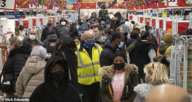 An Asda supermarket on Old Kent Road in London pictured packing with people shopping in December last year - when the capital city was under Tier 4 restrictions