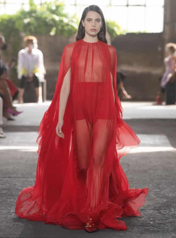 Spring/summer 2021 Valentino model is seen in a red dress.