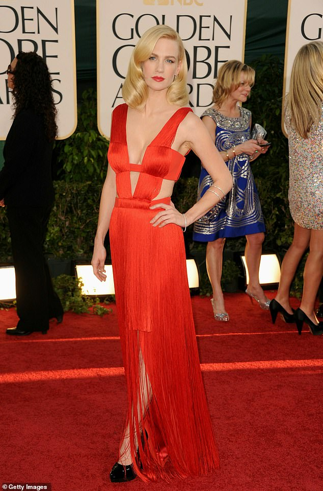 The look: Jones wearing red Versace arrives at the 68th Annual Golden Globe Awards held at The Beverly Hilton hotel in 2011