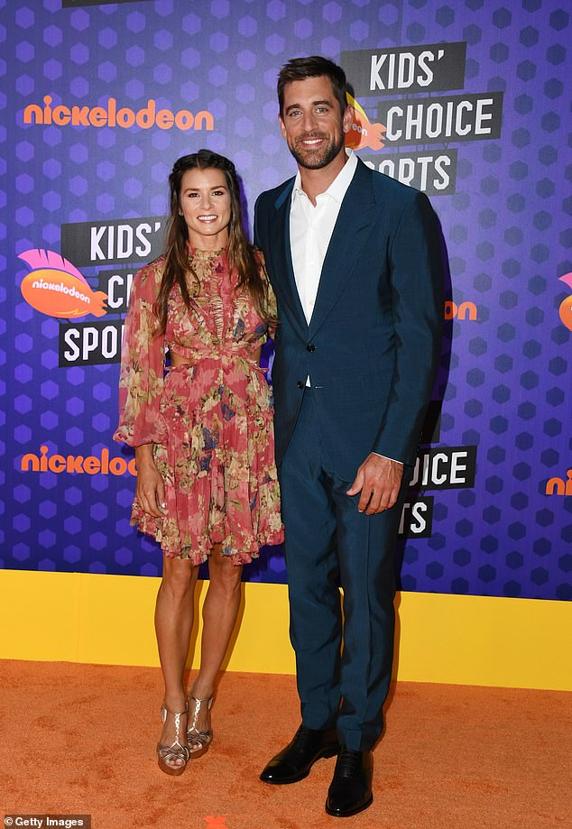 And they're done! As for Aaron, the handsome quarterback famously ended his two-year relationship with the former professional racing driver in July of 2020; Danica and Aaron pictured in 2018
