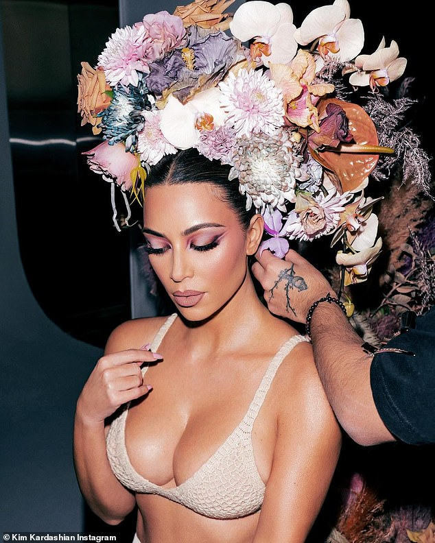 Her new look:In other shots she can be seen wearing a colorful floral headpiece and was in a crotched bra and pant set that made the most of her curves