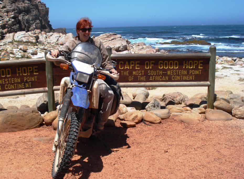 Lois Pryce and her trusty motorbike at the Cape of Good Hope, South Africa.