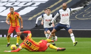 Lucas Moura is tackled by Kyle Bartley in the early stages.