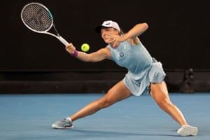 Iga Swiatek stretches for a return during her win over Fiona Ferro.