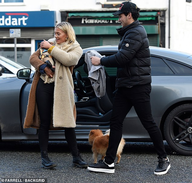 New addition to the family:The couple beamed as they enjoyed a scenic stroll with their pooches including their new puppy, Nelly